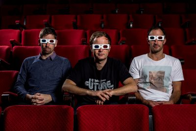 Portrait photography of a three guys in a cinema