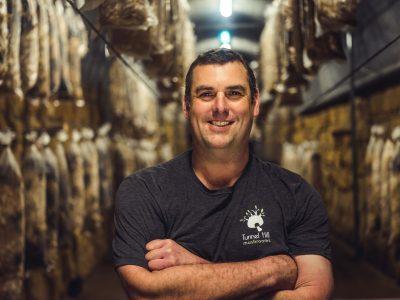 Portrait photography of mushroom grower